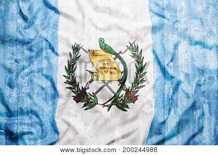 Grunge Style Of Guatemala Flag On Brick Wall