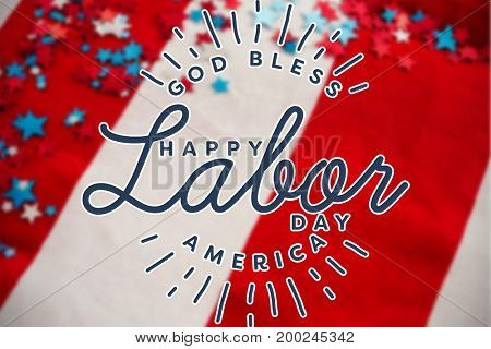 Composite image of happy labor day and god bless America text against star shape decorations arranged on american flag