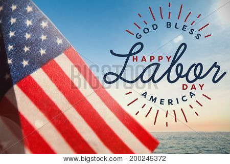 Composite image of happy labor day and god bless America text against beautiful sunset on a sunny day
