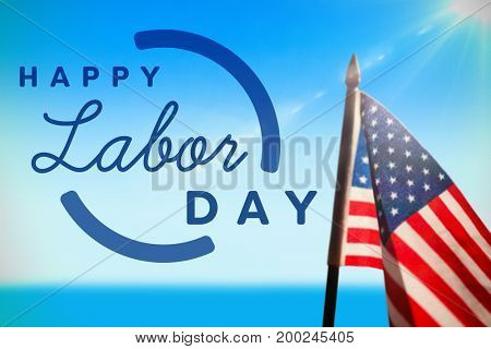 Digital composite image of happy labor day text with blue outline against scenic view of sea against sky