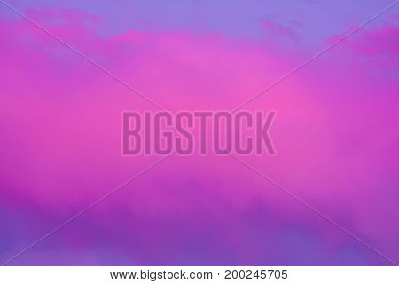 Very large puffy pink cloud with blue and purple sky background
