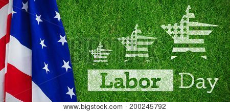 Composite image of labor day text with star shapes American flag against closed up view of grass