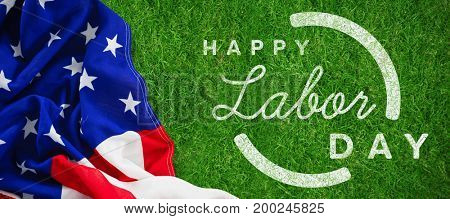 Digital composite image of happy labor day text with blue outline against closed up view of grass