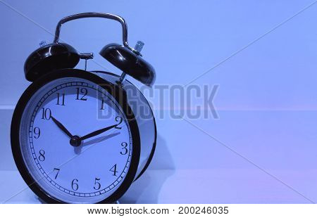 It's time to bed! Retro alarm clock pointing at ten o'clock, with free space for text and design
