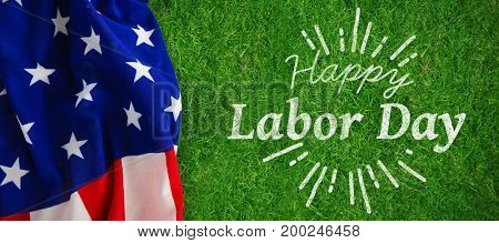 Digital composite image of happy labor day and god bless America text against closed up view of grass
