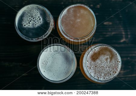 Beer glasses top view on wooden backgeound