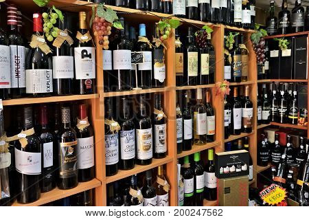 Cascais Portugal - June 13 2017: Shelves with varieties sorts of bottles of wine and port wine in the wine store. Port wine is a Portuguese fortified wine produced exclusively in the Douro Valley in the northern provinces of Portugal