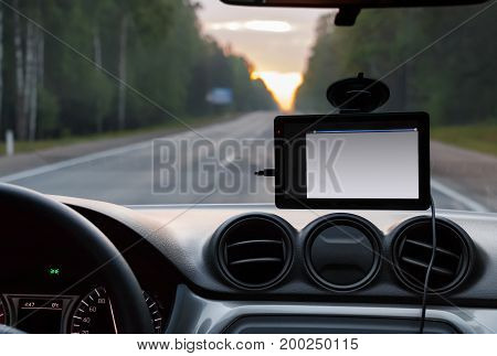 Portable GPS on the windshield of the car