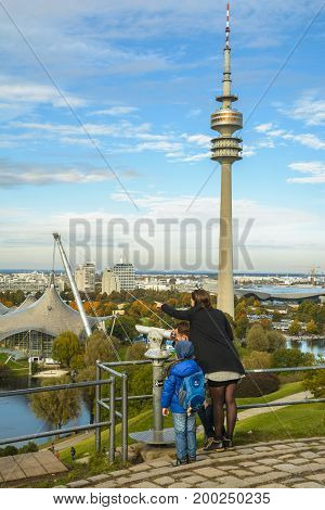 Family of tourists admiring the sights of Olympiapark on October 10, 2016 in Munich Bavaria Germany.