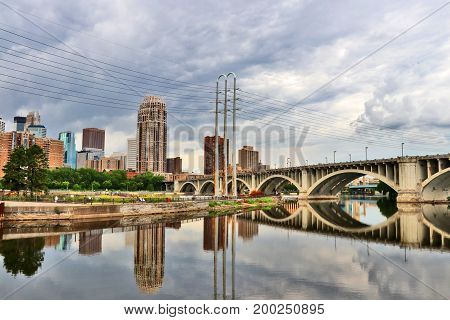 Minneapolis downtown skyline and Third Avenue Bridge above Mississippi river. Midwest USA Minnesota state.