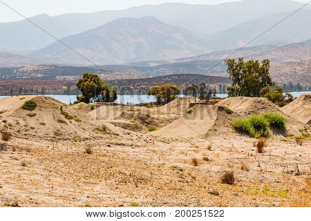 CHULA VISTA, CALIFORNIA - JUNE 30, 2017:  BMX dirt moguls with a view of Otay Lake at the Chula Vista Elite Athlete Training Center, built in 1995 for the training of Olympic athletes.