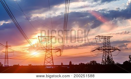 High power electricity poles in urban area. Energy supply distribution of energy transmitting energy energy transmission high voltage supply concept photo.