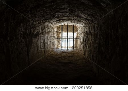 ancient medieval prison window from the inside