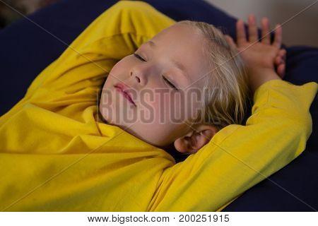 Adorable girl sleeping on examination bed in hospital