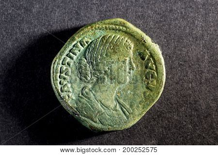 An Old Antique Roman Historical Coin On Black Background