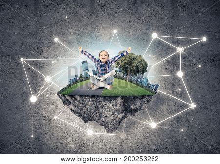 Connection concept floating island and happy kid girl with book sitting on it