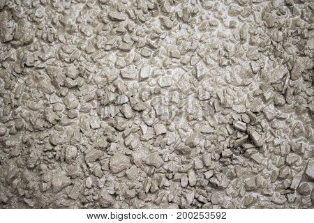 concrete pebble sand water mixed togather at construction site.