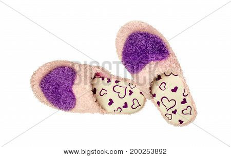 The pink slippers on a white background closeup