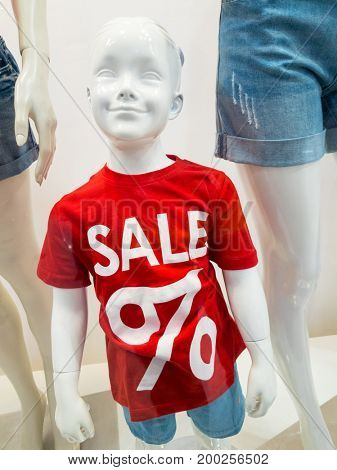 Mannequin child in the store. Sale concept