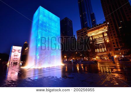 CHICAGO USA - JULY 15 : View of the Crown Fountain in Millennium Park in Chicago on July 15 2017. The fountain is interactive work of public art and video sculpture designed by Jaume Plensa
