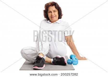 Mature woman with an exercise mat and dumbbells isolated on white background