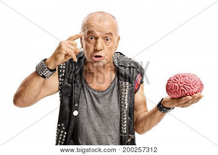 Elderly punker with a brain model holding a finger on his temple asking do you have a brain isolated on white background
