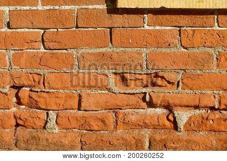 Nineteenth century brick wall with limestone frame