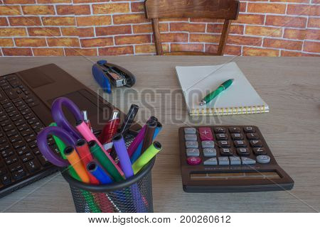 The calculators business owners accounting and technology business computer laptop calculator and documents in the office. Businessperson working in office
