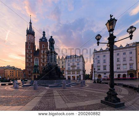 Purple sunrise in the main square of Krakow. Poland.