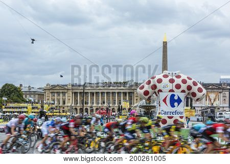 Paris France - 23 July 2017: Blurred image of the peloton riding at full speed in Place de la Concorde in Paris during the last stage of Le Tour de France 2017.