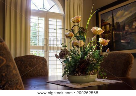 Beautiful Floral Centerpiece on Dining Room Table
