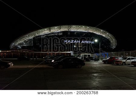 Yoshkar-Ola, Russia - August 9, 2017 Photo of the football stadium Kazan Arena, which is located in Kazan, Russia. Night view from the parking lot