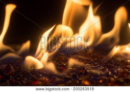 Bright smokeless fire on small glass stones