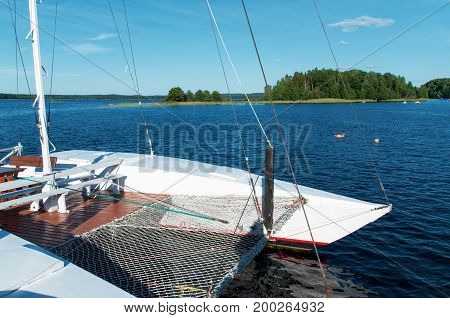 Landscape with yacht and trees on lake