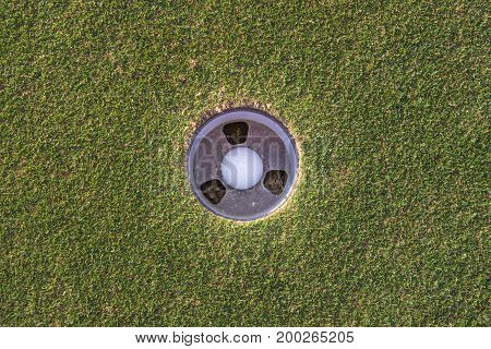Overhead shot of a golf ball in its final hole
