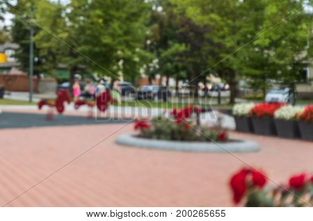 Public's Playground In City. Defocused And Blurred Image For Background Of Playground, Activities At