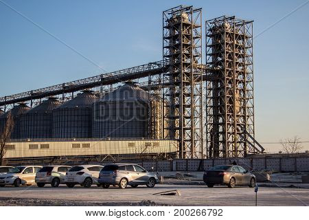 Grain mill elevator and silos of compound feed plant and parking for cars