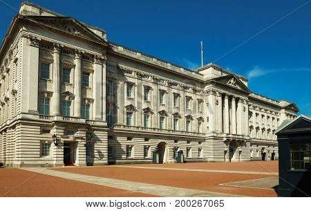 The landscape view of Buckingham Palace in London, United Kingdom.