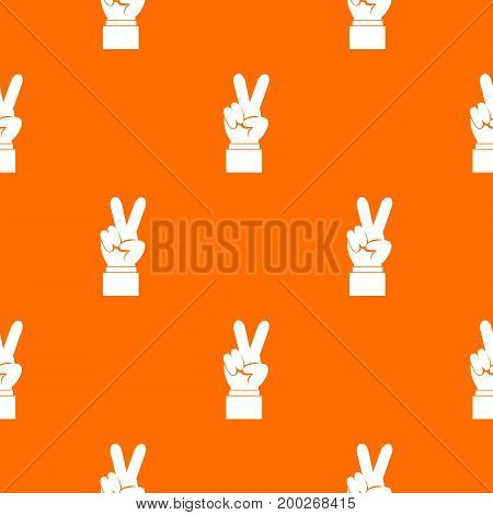 Hand with victory sign pattern repeat seamless in orange color for any design. Vector geometric illustration