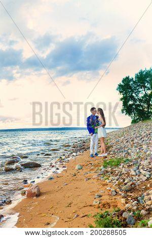 Portrait of beautiful young couple enjoying nature