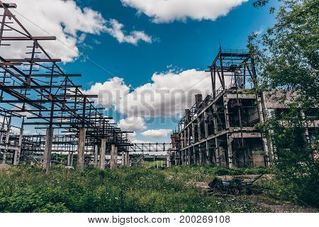 Ruins of abandoned polluted industrial factory, toned