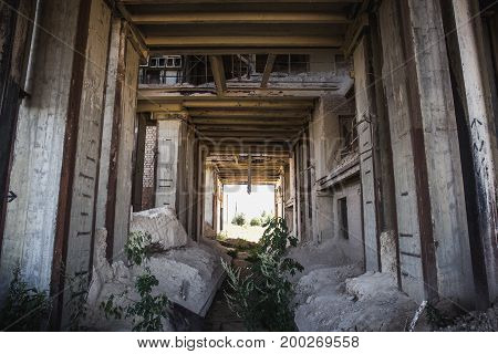 Abandoned industrial building, corridor view, tunnel view, perspective