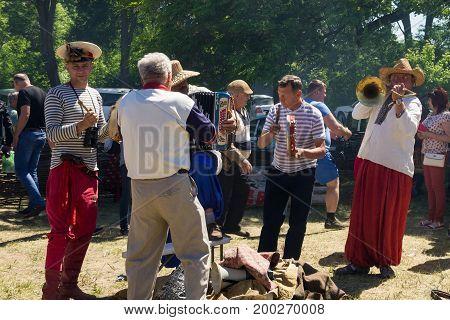 Street Folk Musicians On Performing During Festival