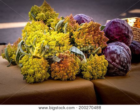 Romanesco and red cabbage displayed at the local farmer's market