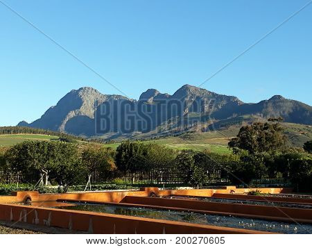 Beautiful mountains and green fields with blue sky