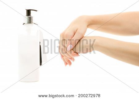 Hand cream with dispenser female hands on white background isolation