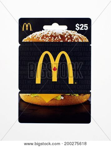 MONTREAL CANADA - JULY 30 2017 : Mcdonalds 25 dollar gift card on a white background