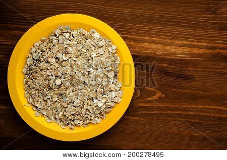 Oatmeal On A Wooden Table.