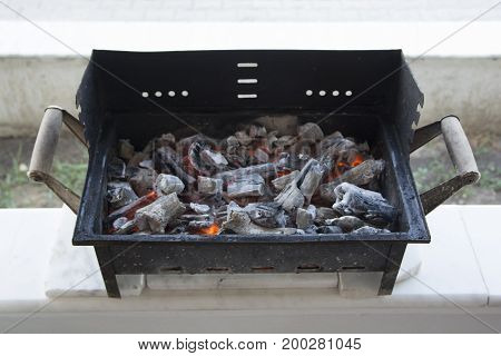 Ashes in barbecue. The coals are warm enough.embers