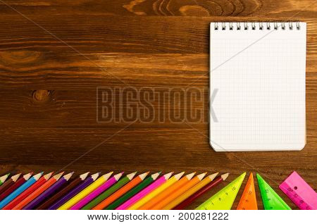 School Supplies (pencil, Pen, Ruler, Triangle) On Blackboard Background Ready For Your Design .